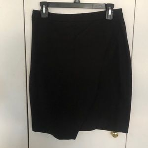 Simple black pencil skirt with cross front detail